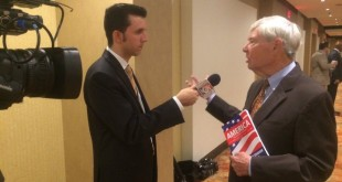 WUFT News reporter Nestor Montoya interviews former Florida Governor and U.S. Senator Bob Graham at the Democratic National Convention in Philadelphia, July 26, 2016. (Aaron Abell/WUFT News)