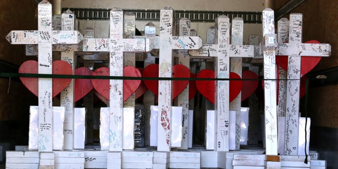 Following the 2016 Pulse nightclub shooting in Orlando, 49 crosses honoring the victims were moved to the Orange County Regional History Center. Sparked by the shooting, Florida Gov. Rick Scott will request almost $6 million for more counterterrorism agents in the state. (AP file photo)