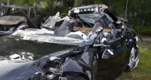 This photo provided by the NTSB via the Florida Highway Patrol shows the Tesla Model S that was being driven by Joshua Brown, who was killed, when the Tesla sedan crashed while in self-driving mode on May 7, 2016. (Florida Highway Patrol)