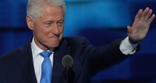 Former President Bill Clinton arrives on stage to deliver remarks on Tuesday, the second day of the Democratic National Convention, at the Wells Fargo Center in Philadelphia.