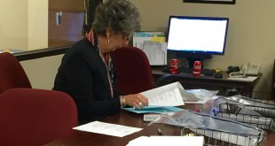 Alachua Supervisor of Elections Pam Carpenter reviews voter turnout results following the primary election Tuesday, August 30, 2016. (Nicole Kocian/WUFT News)