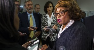 FILE - In this Aug. 13, 2015 file photo, Rep. Corrine Brown, D-Fla. talks with the press in Tallahassee, Fla. Rep. Brown, who more than two decades ago became one of the first blacks elected to Congress from Florida since reconstruction, is battling to stay in office amid a criminal indictment and a revamped district that includes thousands of new voters.(AP Photo/Mark Wallheiser, File)