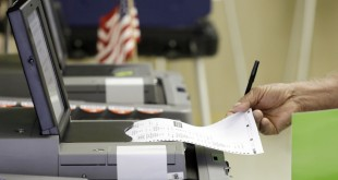 A voter casts his primary vote, Tuesday, Aug. 30, 2016, at Precinct 33, in Hialeah, Fla. Florida voters will select the nominees for U.S. Senate, decide whether to amend the state constitution to give a property tax break to promote solar energy and have a say in who should represent them in the U.S. House. (AP Photo/Alan Diaz)