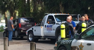Elite Towing of Gainesville pulls a car out of Lake Santa Fe in Melrose, Fla. Wednesday, August 23, 2016.  Alachua County Sheriff's Office found Joel Costantino, 68, of Melrose, dead in the vehicle after receiving a call about the submerged vehicle early in the morning. (Patricia Ochoa/WUFT News).