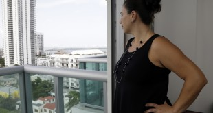 In this Wednesday, Aug. 3, 2016 photo, Jessica Ardente poses for a photograph in her apartment in Miami. Ardente is four months pregnant and lives within the one-square mile radius where the Zika virus has been detected. The CDC has advised pregnant women to avoid travel to the Miami neighborhood of Wynwood where mosquitoes are apparently transmitting Zika directly to humans. (AP Photo/Lynne Sladky)