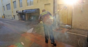 Melvin Gaitan, from the Miami Beach Sanitation Dept., washes down alley ways Friday, Aug. 19, 2016, Miami Beach, Fla., with a high pressure water machine that is set to 250 degrees Fahrenheit, which kills any bacteria or mosquito larvae that could be growing in still waters. (C.M. Guerrero/El Nuevo Herald via AP)