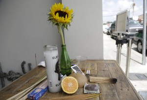 An offering of flowers, fruit, incense and candles sits outside of Zak the Baker restaurant and bakery, in hopes of warding off the Zika virus, Wednesday, Aug. 3, 2016, in the Wynwood neighborhood of Miami. The CDC has advised pregnant women to avoid travel to the Miami neighborhood of Wynwood where mosquitoes are apparently transmitting Zika directly to humans. This arts district which has numerous galleries, restaurants, and bars, is popular with tourists and locals. (AP Photo/Lynne Sladky)