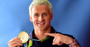 Ryan Lochte poses with his gold medal on the Today show set on Copacabana Beach last week.