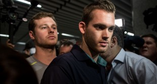 U.S Olympic swimmers Gunnar Bentz and Jack Conger leave the police headquarters at International departures of Rio de Janiero's Galeo International airport on Thursday.