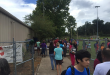 Buchholz High students get picked up by their parents from the Boys and Girls Club, which is near the school. The students were evacuated to the club following a bomb threat this morning. (Leah Marshall/WUFT News)