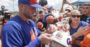 Tim Tebow signs autographs for fans at the New York Mets' complex in Port St. Lucie on Monday. The 2007 Heisman Trophy winner and former NFL quarterback got to the complex early Monday and started his first workout as part of the team's instructional league team. (AP Photo/Wilfredo Lee)