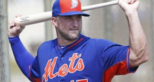 Former Gator quarterback Tim Tebow stretches before batting practice on Monday at the New York Mets' complex in Port St. Lucie, Florida. The 2007 Heisman Trophy winner got to the complex early Monday and started his first workout as part of the Mets' instructional league team. (AP Photo/Wilfredo Lee)