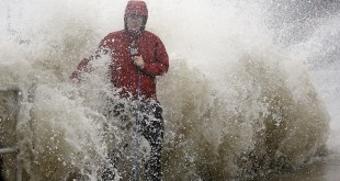 A news reporter doing a stand up near a sea wall in Cedar Key, Fla., is covered by an unexpected wave as Hurricane Hermine nears the Florida coast, Thursday, Sept. 1, 2016. (AP Photo/John Raoux)