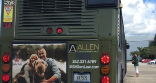 Several RTS buses' back panels can now be seen with a dark green vinyl sticker placed right above Allen Law Firm's contact information. Underneath the sticker is a religious symbol, the Jesus Fish, which was covered after a resident said it was unconstitutional. (Mariana Riquezes/WUFT News)