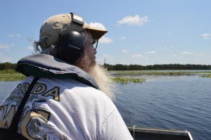Bruce Jaggers, an invasive plant biologist for the Florida Fish and Wildlife Conservation Commission, looks out on Lake Rousseau. Invasive plants on the lake are being treated with herbicides. (Cecilia Mazanec/WUFT News)