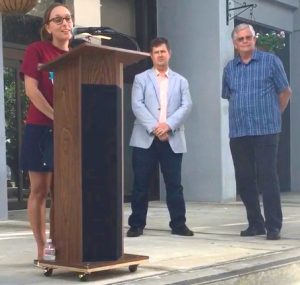 Paula Roetscher speaks at Welcoming Week Proclamation on Thursday. Also pictured: Gainesville Mayor Lauren Poe and Alachua County commissioner Robert Hutchinson. (Jessica Gonzalez/WUFT News)