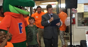 Mayor Lauren Poe announces that Sept. 15 will be known as Action Hunger Day in the city of Gainesville. Along with Poe and University of Florida mascot Albert, sheriff Sadie Darnell was also at the event at Bread of The Mighty Food Bank. (Ramon Pena/WUFT News)