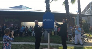 "Florida Museum Director Douglas Jones and UF President Kent Fuchs unveil the historical marker. ""The Florida Museum is a very special place,"" Fuchs said. (Lindsey Spatola/WUFT News)"