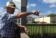 Live Oak councilman Keith Mixon points to the Live Oak Atlantic Coastline Freight Station where passengers would get off and on trains in Live Oak. The depot could hold live music to greet passengers at their stops. (Janiece Sebris/WUFT News)