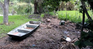 The backyard of June Proffit, 92 years old, was ravaged by the flooding and winds of Hermine. A random boat was carried onto her property from the flooding, and left there after the water left. (Josh Kimble/WUFT News)