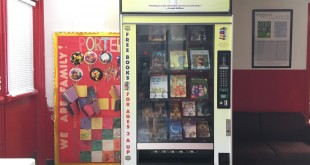 "The ""Feed Your Brain"" book vending machine encourages reading in the Porters Community. The book vending machine is stocked with a variety of free books and is open to everyone. (Photo by WUFT News/Lindsey Spatola)"