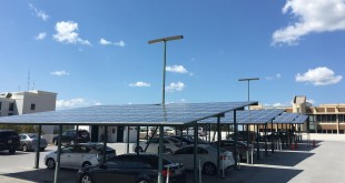 Solar panels give shade to cars on top of McGurn Management Company's Downtown Parking Garage, at 220 SE Second Avenue.