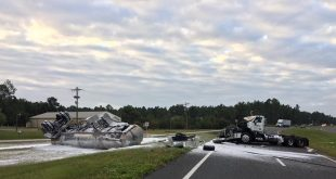 Gainesville Fire Rescue Hazardous Materials Team and Airport Firefighting Team sprayed a foam blanket  to contain a jet fuel spill after a semi-truck carrying the fuel flipped on US Highway 301 in October. (Photo courtesy of Gainesville Fire Rescue.)