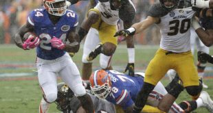 Florida running back Mark Thompson (24) runs for yardage as he gets by Missouri safety Ronnell Perkins, center, and linebacker Michael Scherer (30) during the first half of an NCAA college football game, Saturday, Oct. 15 in Gainesville, Fla. (AP Photo/John Raoux)