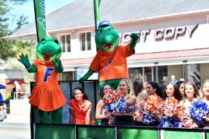 Albert and Alberta share a float with the UF Dazzlers. (Grace King/WUFT News)