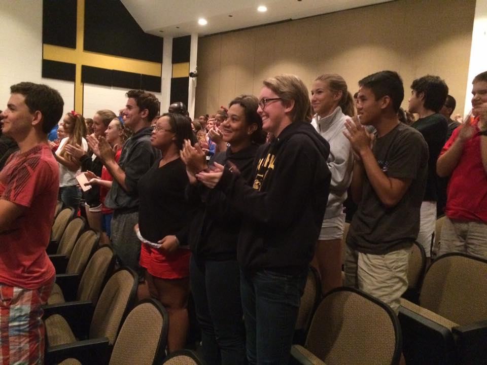Fellow Buchholz band members and others stand and clap at the end of ceremony. (Maggie Lorenz/WUFT News)