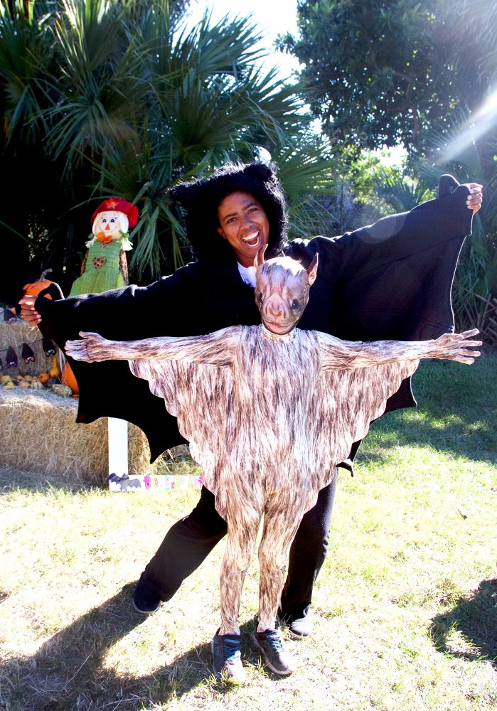 Joshua Radcliffe, 8, poses Saturday in his vampire bat costume with Demetria McBride, an intern at the Lubee Bat Conservancy in Gainesville, during the conservancy's the 12th annual Florida Bat Festival. (Vedrana Damjanovic/WUFT News)