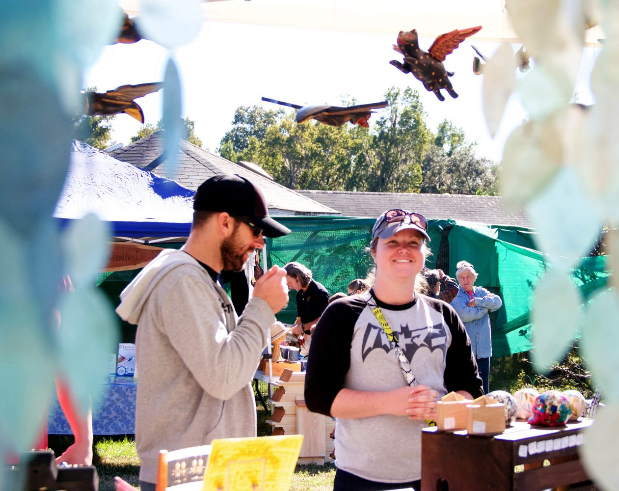 "Danne and Christy Farell, from Tampa, buy souvenirs Saturday at the festival's arts and crafts booth. ""We love bats,"" Christy Farrell said. ""It's absolutely worth coming here."" (Vedrana Damjanovic/WUFT News)"