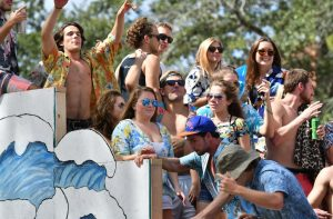 College students party on a beach-themed float. (Grace King/WUFT News)