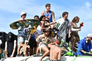 College students ride on a jungle-themed float, one of the last of the parade. (Grace King/WUFT News)