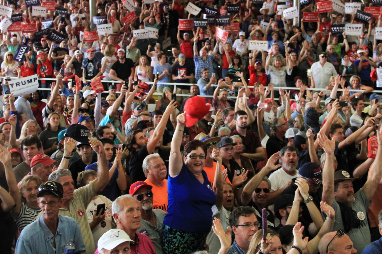 """A member of the crowd waves her hat at Donald Trump during his speech Wednesday afternoon. Event organizers estimated that 10,000 people attended the rally, while Trump claimed in his speech that the number was closer to 15,000. The crowd frequently interrupted Trump's speech with cheers, boos and chants, including perennial favorites """"Build the Wall"""" and """"Lock Her Up."""""""