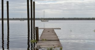High levels of water from Friday's storm flood a dock in the St. Johns River. Paul Flateau, a captain at the Putnam County Emergency Services said flooding from the storm caused a lot of property damage throughout the county. (Cecilia Mazanec/WUFT News)