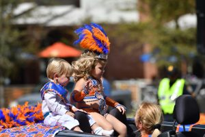 Starlight Pageant contestants wave at the crowds during the parade. (Grace King/WUFT News)