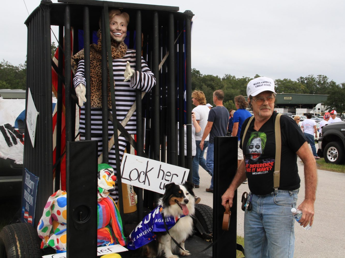 """Bob Gaffney and his dog Dally stand in front of an imprisoned mannequin of Hillary Clinton before Trump's rally Wednesday morning. Throughout the day, chants of """"Lock her up!"""" were audible from the people waiting in line, and from audience members during the rally. Trump also reiterated his plan to appoint a special prosecutor to investigate the Clintons after he is elected president, and emphasized the need to investigate the FBI's investigation into Sec. Clinton's email scandal."""