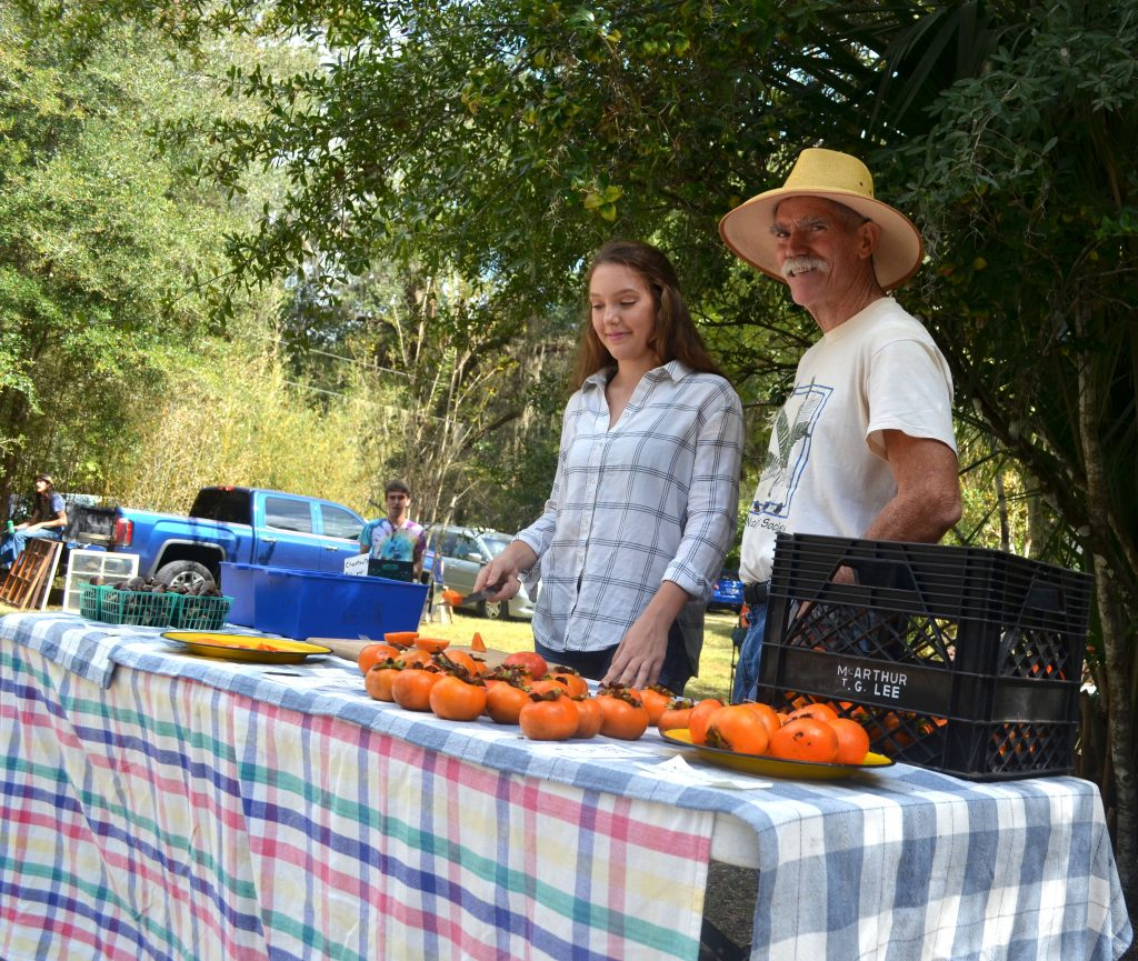 Gary and Lili Schultz came to the Fall Festival to sell kaki fuyu and chestnuts. (Nicole Dan/WUFT News)