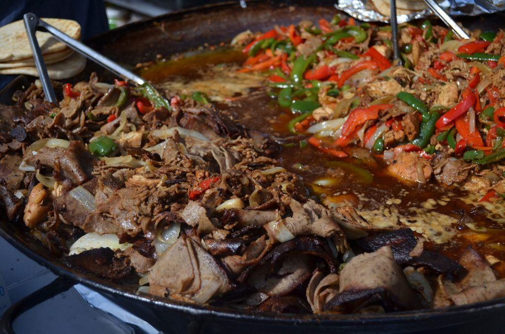 Marinated lamb and chicken are cooked at the tent for Greek Flame Foods. (Nicole Dan/WUFT News)