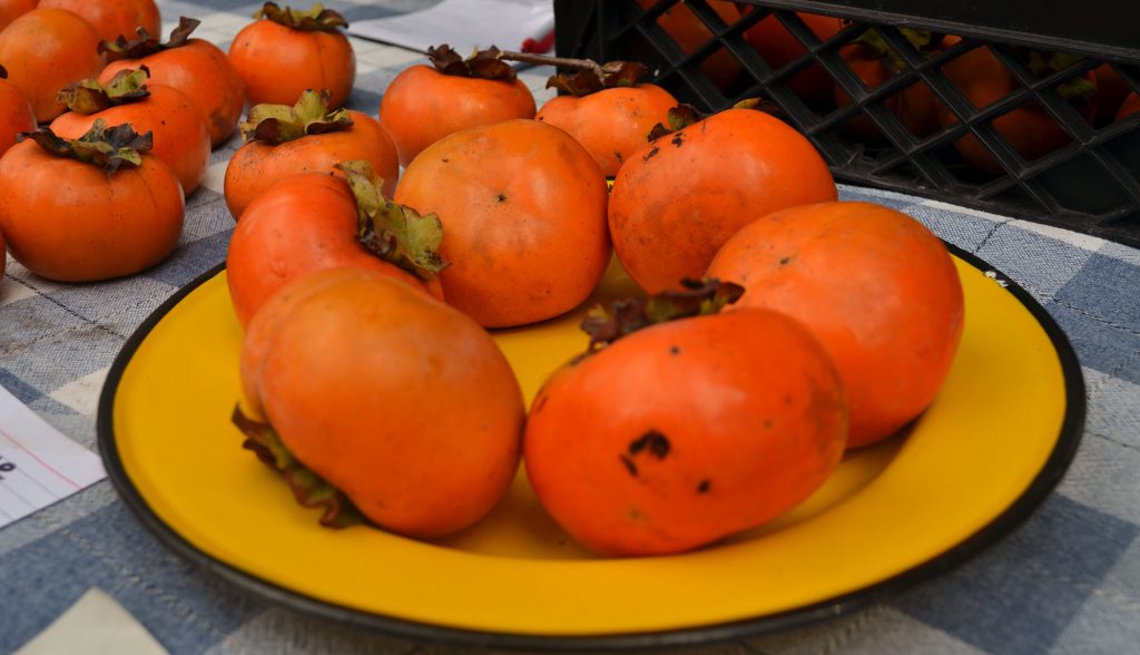 These kaki fuyu, or Asian persimmons, came from Schultz and Daughter's farm in Alachua. (Nicole Dan/WUFT News)