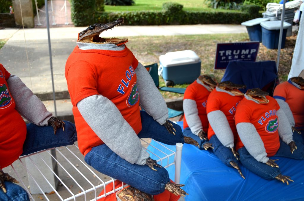 Stuffed toys with real Alligator heads, hands, and feet, are sold by Mike and Lisa Pitts. (Nicole Dan/WUFT News)