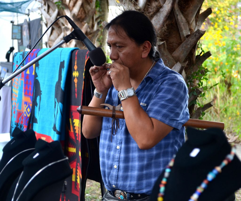 Carlos Vegas performs at this tent at Micanopy Fall Festival. He came to Micanopy from Nashville to sell jewelry from The Wind Native American Art. (Nicole Dan/WUFT News)
