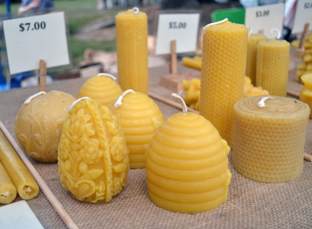 Cross Creek Honey sells beeswax candles in different shapes. (Nicole Dan/WUFT News)