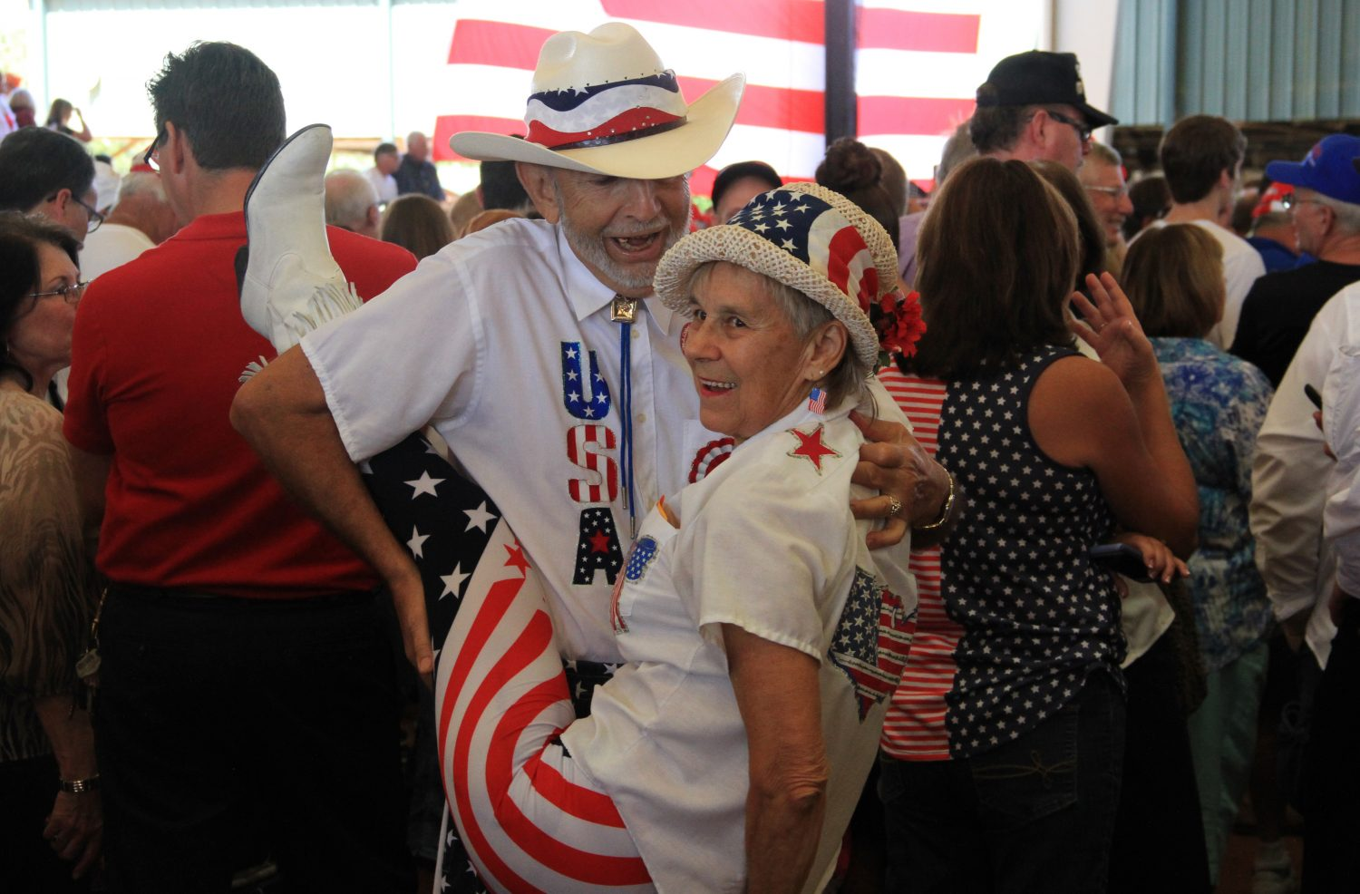 Elaine Lee and Veldon Colby dance while waiting for Donald Trump to speak Wednesday afternoon. The pair danced to the soundtrack of the Rolling Stones and Backstreet Boys that played over the course of the day, and occasionally during Trump's roughly hour-long speech.