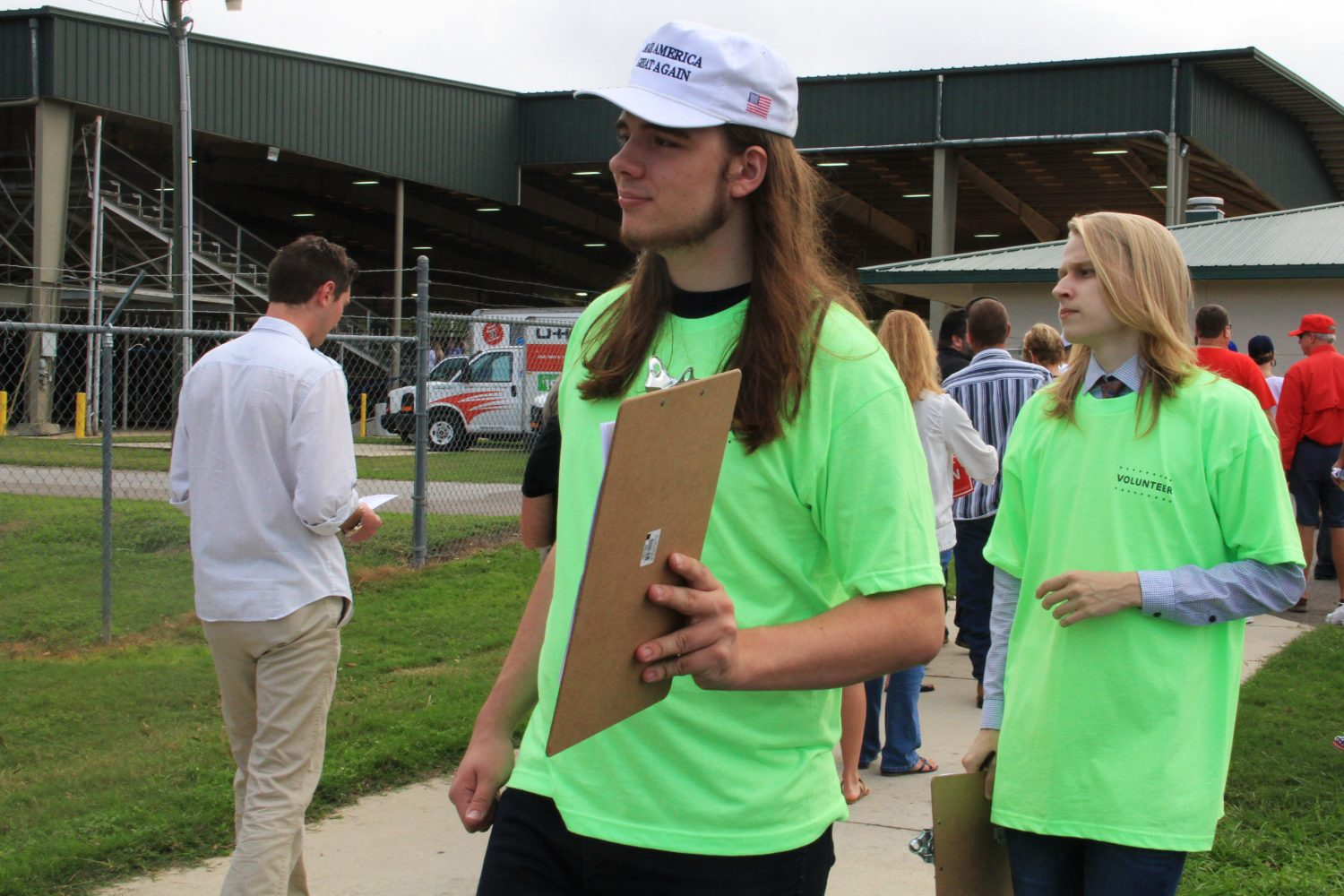 """College students Simon Dickerman (left) and Jacob Waitfield register people to receive absentee ballots. Dickerman said that most of the people he had talked to seemed """"skeptical,"""" and that several had told him that they didn't believe their votes would be counted if they didn't cast them in person."""
