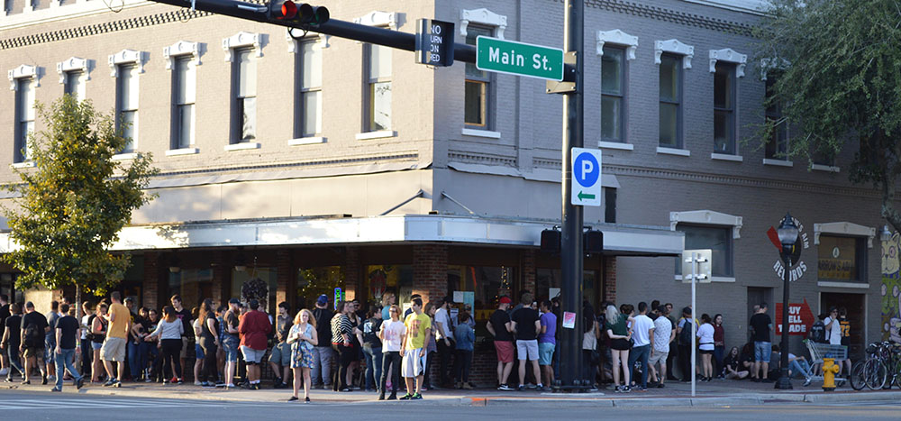 People wait in a line for a show that wraps around the block. Curtis Grimstead, an accountant for the Fest, said the festival has about 6,000 attendees in total. (Cecilia Mazanec/WUFT News)