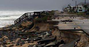 An official vehicle navigates debris as it passes along Highway A1A after it was partial washed away by Hurricane Matthew, Friday, Oct. 7, 2016, in Flagler Beach, Fla. Hurricane Matthew spared Florida's most heavily populated stretch from a catastrophic blow Friday but threatened some of the South's most historic and picturesque cities with ruinous flooding and wind damage as it pushed its way up the coastline.  (AP Photo/Eric Gay)