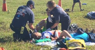 First responders treat a wounded victim Tuesday at the Gainesville Regional Airport as part of a drill in preparation for a real crash. The victim is actually an uninjured volunteer. (Leah Shields/WUFT News)