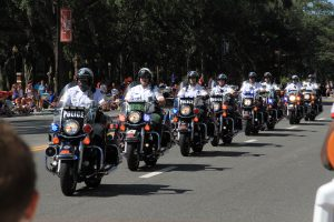 Gainesville Police and Alachua County Sheriff's deputies ride in formation down University Avenue.(Jordanne Laurito/WUFT News)
